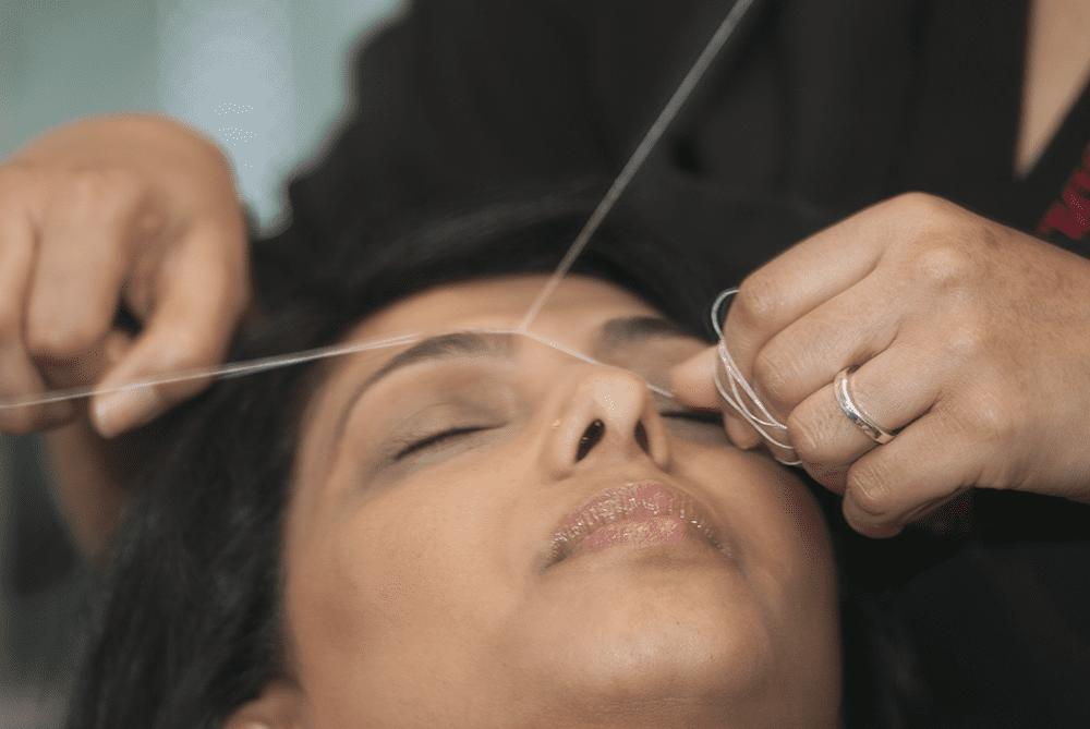 Threading eyebrow hair
